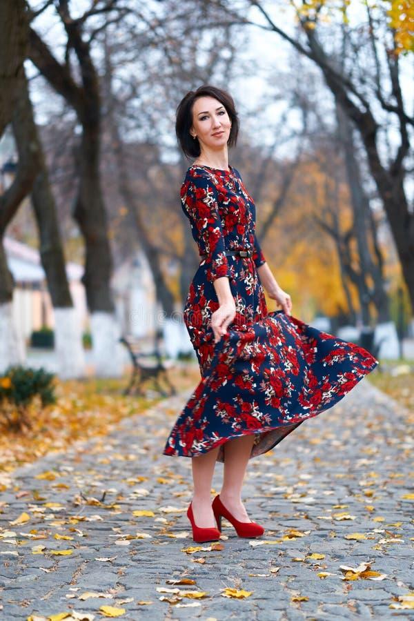 Beautiful elegant woman posing in a city street, autumn season royalty free stock photography