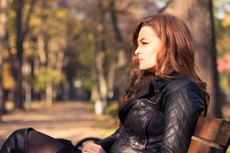 Beautiful elegant woman standing in autumn park stock images
