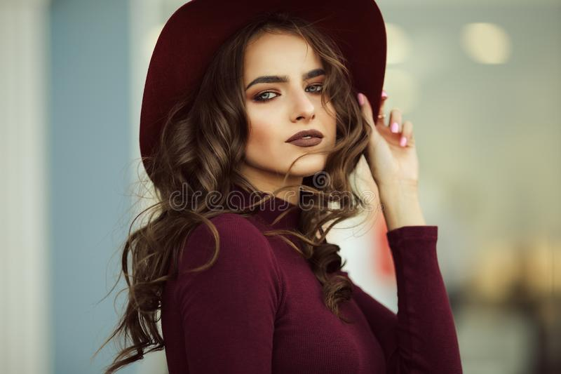 Beautiful elegant woman is wearing fashion autumn clothes , fall concept. Beautiful elegant woman is wearing fashion autumn clothes in red colors , fall concept royalty free stock image