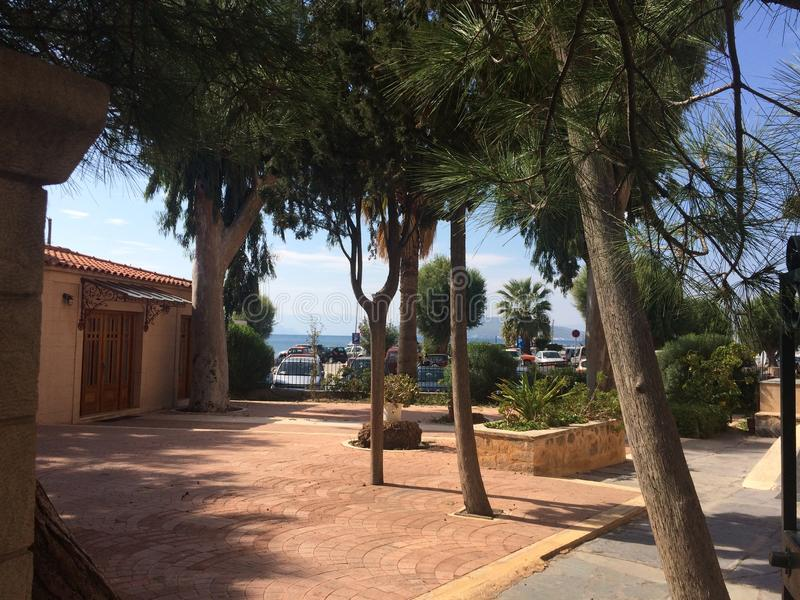 Beautiful embankment with trees, Aegina Greece. Green trees, embankment beautiful place for relax. royalty free stock photos