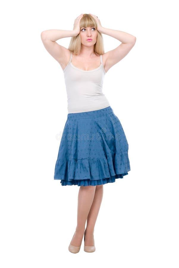 Beautiful emotional blonde in a dark blue skirt