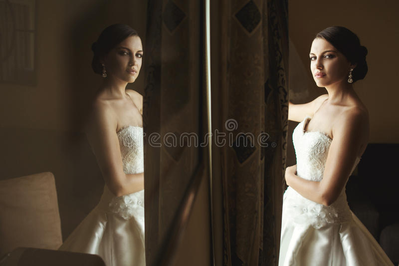 Beautiful emotional french brunette bride reflection in picture royalty free stock image