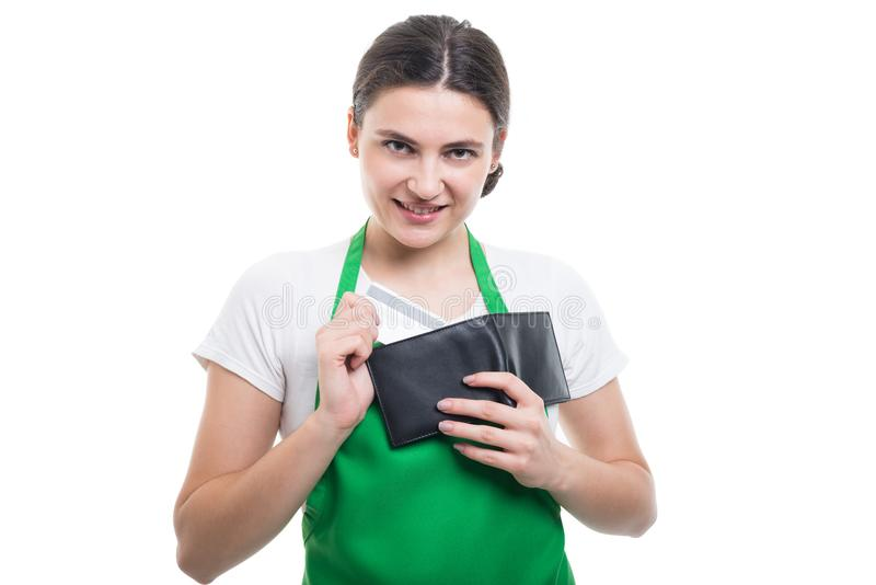 Beautiful employee girl taking out credit card royalty free stock images