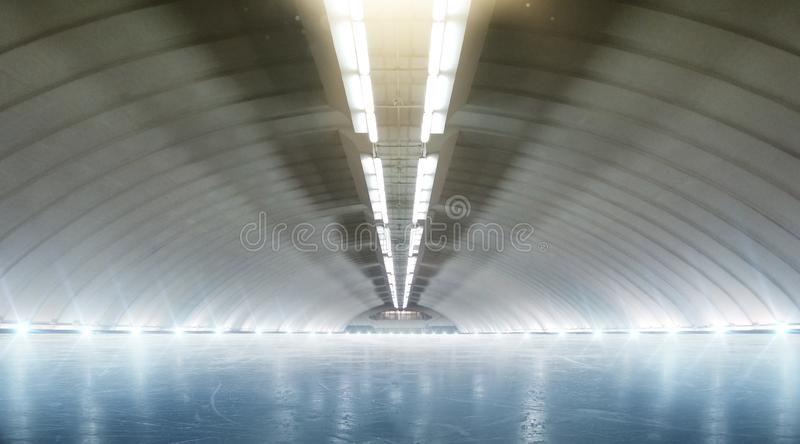 Beautiful empty winter ice rink with lights. Sport royalty free stock images