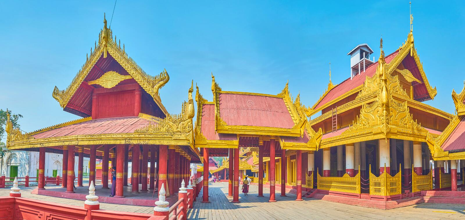The wooden buildings of Royal Palace in Mandalay, Myanmar. The beautiful emsemble of Royal Palace buildings, richly decorated with gilden carved elements royalty free stock photo