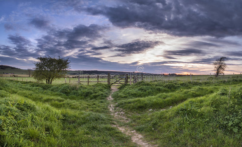 Beautiful English countrysidepanorama landscape over fields at. Stunning English countryside panorama landscape over fields at sunset stock photo