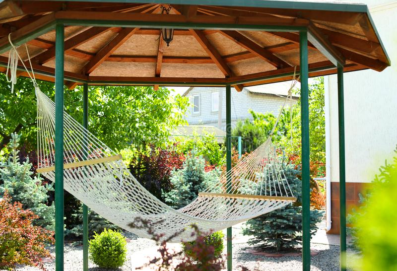 Beautiful English style garden with comfortable hammock royalty free stock images