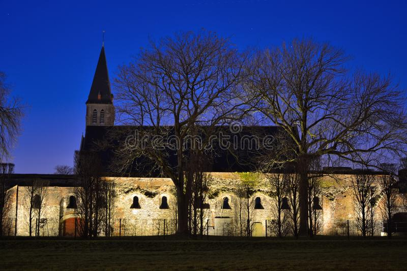 Beautiful enlightened abby wall and church. Beautiful enlightened old classic abby wall and church at night in the city of Ghent, Belgium stock photography