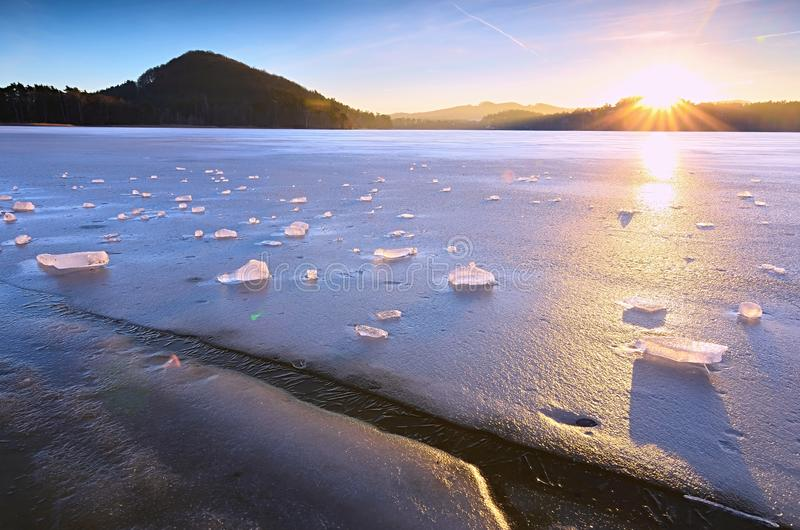 Beautiful epic ice crystal in the frozen bay. Sun rays reflection stock photos