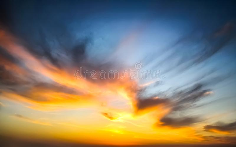 Beautiful epic sunset. Dramatic sunset sky with clouds for background royalty free stock image