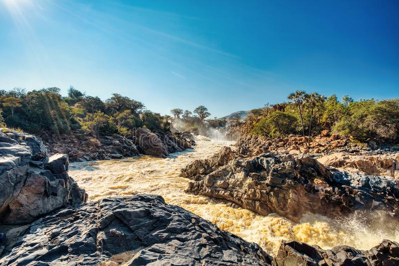 Epupa Falls on the Kunene River in Namibia. Beautiful Epupa Falls on the Kunene River in Northern Namibia and Southern Angola border. Sunrise sunlight in water royalty free stock images