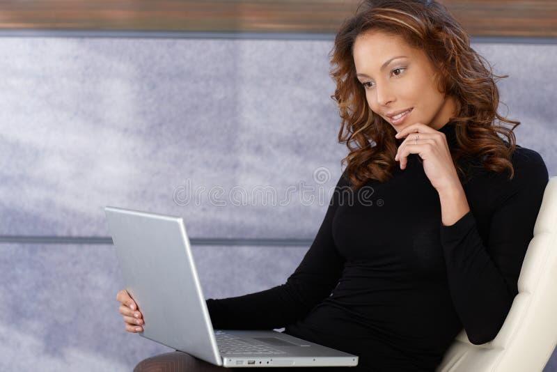 Download Beautiful Ethnic Female Using Laptop Computer Stock Image - Image: 23992827