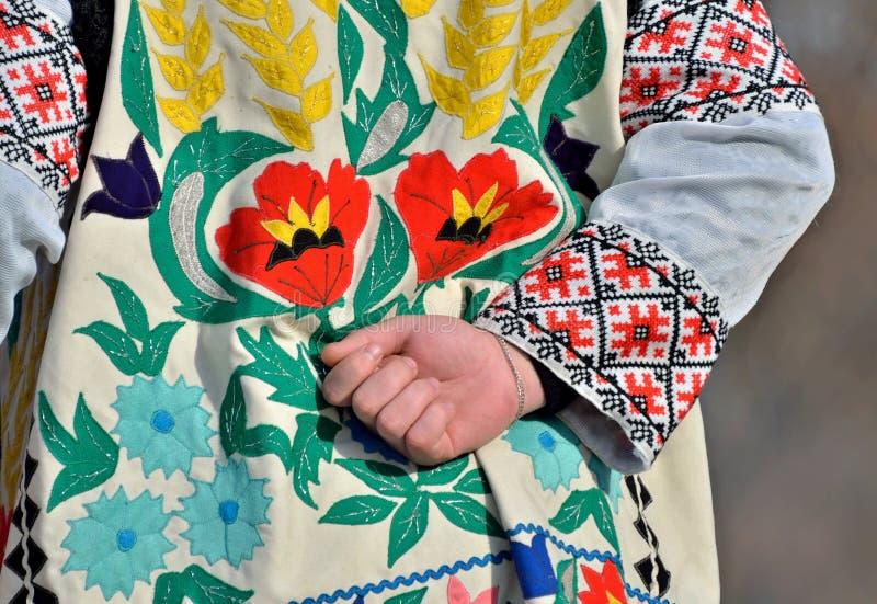 Beautiful ethnic ukrainian ornamental embroidery with flowers on man`s holiday shirt and waistcoat , Bukovina region stock image