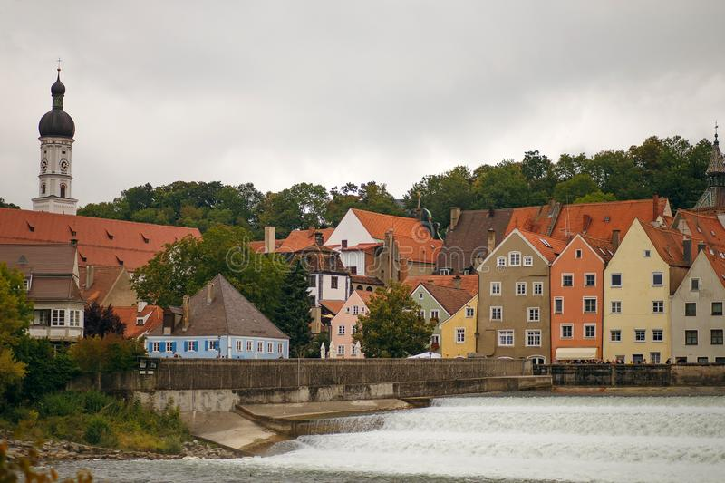 Beautiful European city with cascading waterfalls and old houses stock photography