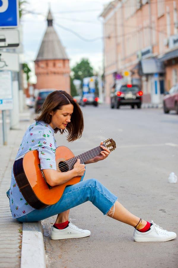 Beautiful european woman with guitar royalty free stock photo