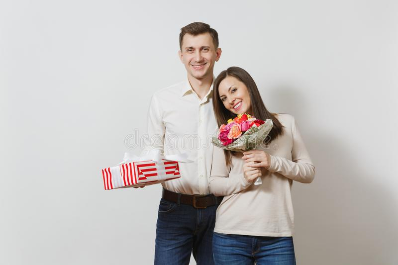 Beautiful European young people on a white background. Emotions, family concept. stock photo