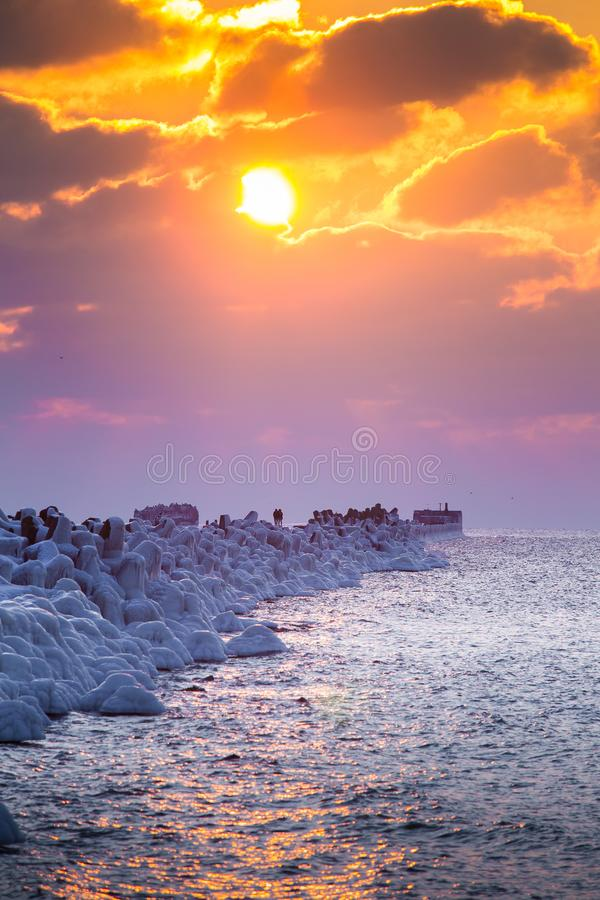 A beautiful evening landscape of a frozen breakwater in the Baltic sea. Winter landscape at the beach. stock images