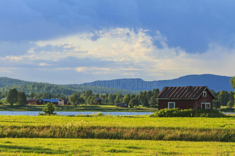 Beautiful evening light and houses at the river. Warm season royalty free stock photo