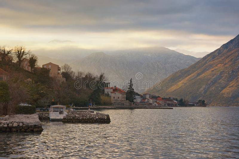 Beautiful evening Mediterranean landscape. Montenegro, Adriatic Sea. View of Bay of Kotor and Prcanj town stock image