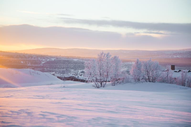 A beautiful evening scenery of a small Norwegian town Roros in winter. Sunset scenery in Norway. royalty free stock image
