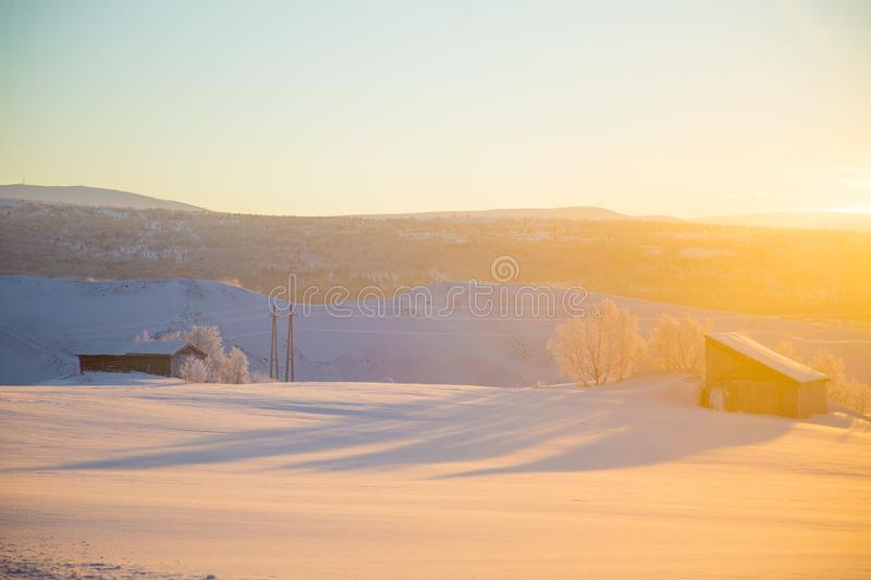 A beautiful evening scenery of a small Norwegian town Roros in winter. Sunset scenery in Norway. royalty free stock images