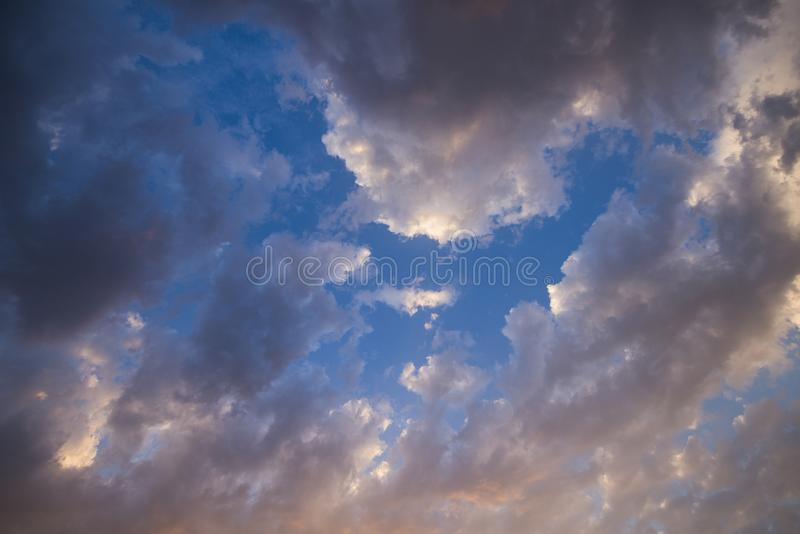 Evening sky with colorful rain clouds stock photography