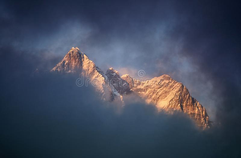 Beautiful sunset red colored view of Lhotse with beautiful clouds, Khumbu valley, Nepal royalty free stock photography