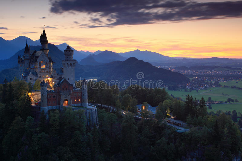 Beautiful evening view of the Neuschwanstein castle, with autumn colours during sunset, Bavarian Alps, Bavaria, Germany royalty free stock images