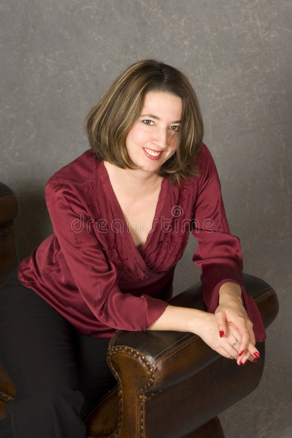 Beautiful Everyday Woman Seated Stock Image