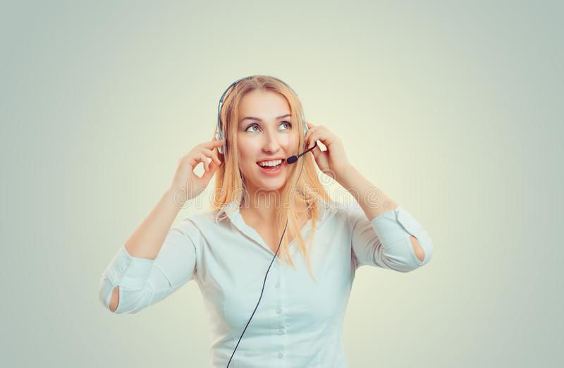 Woman in headsets are looking up happy smiling while working stock photography