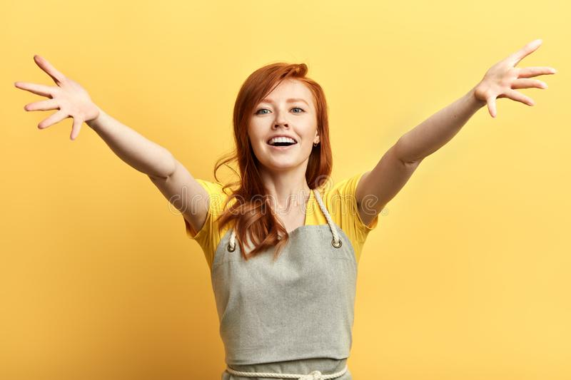 Beautiful excited happy woman open arms for hug looking at the camera . stock photography