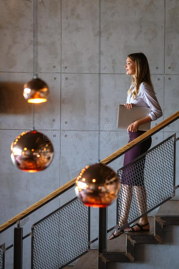 Beautiful executive business woman, ceo, coworker at the workspace office. Beautiful executive business woman, ceo, coworker, entrepreneur at the workspace royalty free stock photography