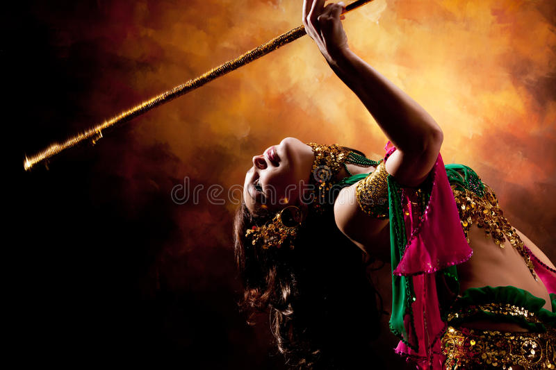 Beautiful exotic belly dancer woman. A rot-green costume royalty free stock image