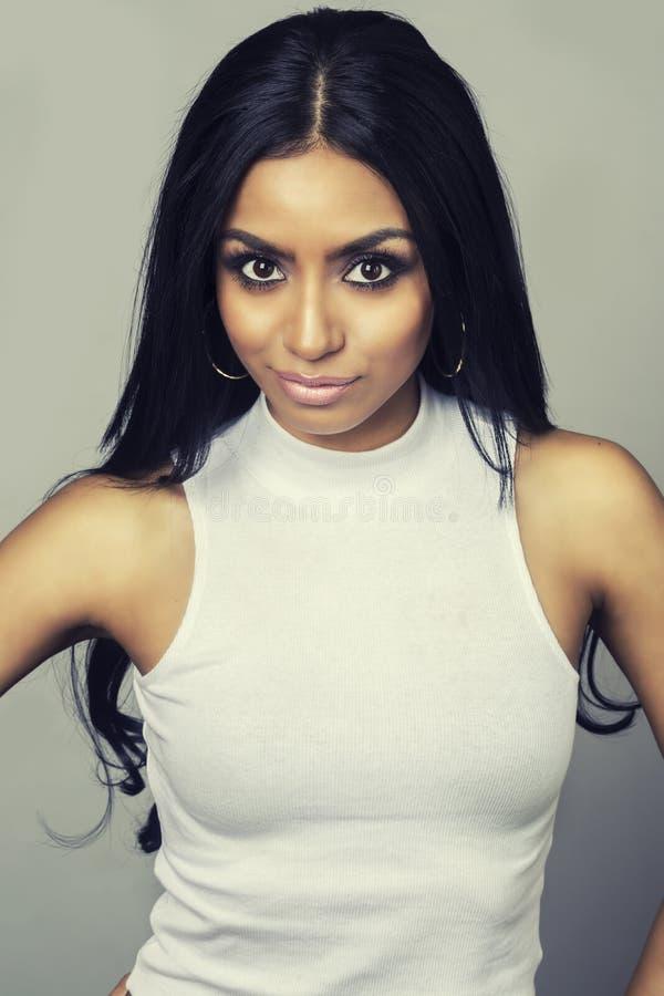 Beautiful exotic young woman stock photo