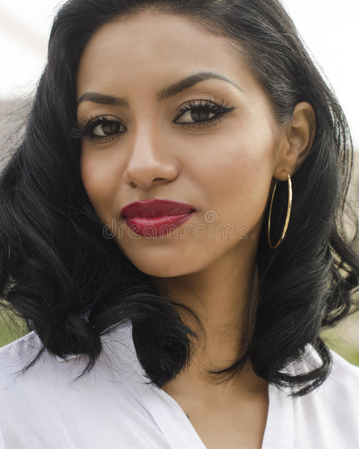 Beautiful exotic young woman royalty free stock photography