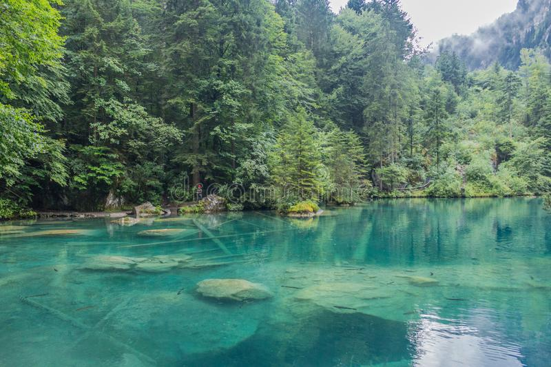 Beautiful exploration tour through the mountains in Switzerland. - Blausee/Switzerland. August 2019 royalty free stock photo