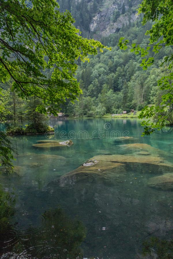 Beautiful exploration tour through the mountains in Switzerland. - Blausee/Switzerland. August 2019 stock photography