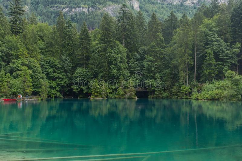Beautiful exploration tour through the mountains in Switzerland. - Blausee/Switzerland. August 2019 royalty free stock image