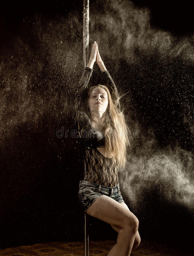 Beautiful expressive dencer dancing at studio with flour stock photography
