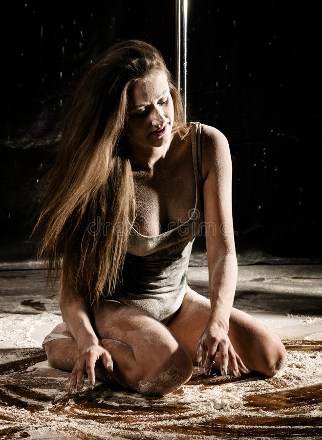 Beautiful expressive dencer dancing at studio with flour or smoke stock image