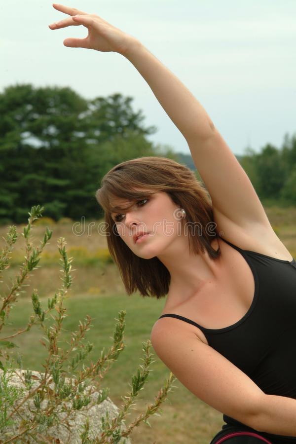 Beautiful Expressive Female Dancer with Arms Exten royalty free stock image