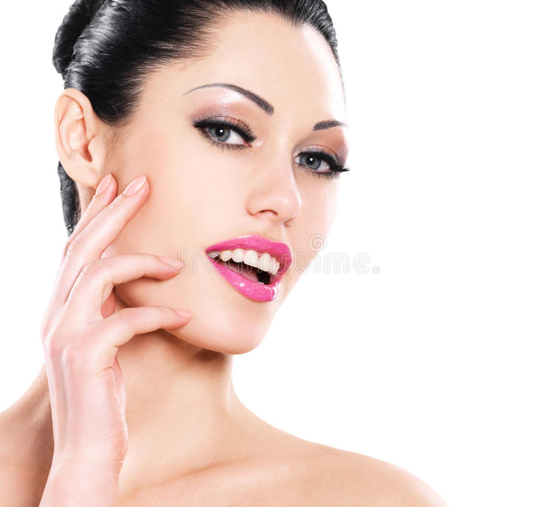 Beautiful expressive woman cares of the skin face stock photos