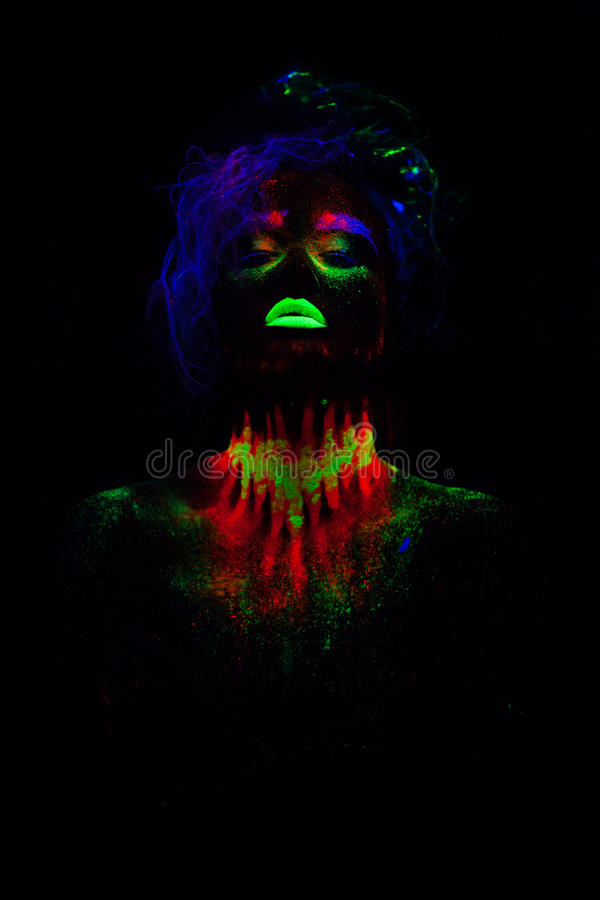 Beautiful extraterrestrial model woman with blue hair and green lips in neon light. It is portrait of beautiful model royalty free stock photo