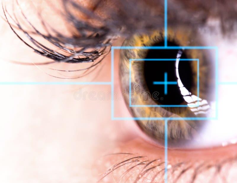 Beautiful Eye with laser. Close-up stock photos