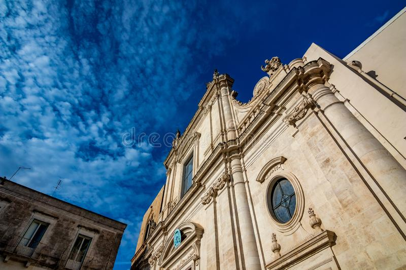 Architecture. Puglia. Southern Italy. Beautiful facade of building in Puglia. Mediterranean architecture of Southern Italy. Scenery summer blue-sky day with royalty free stock images