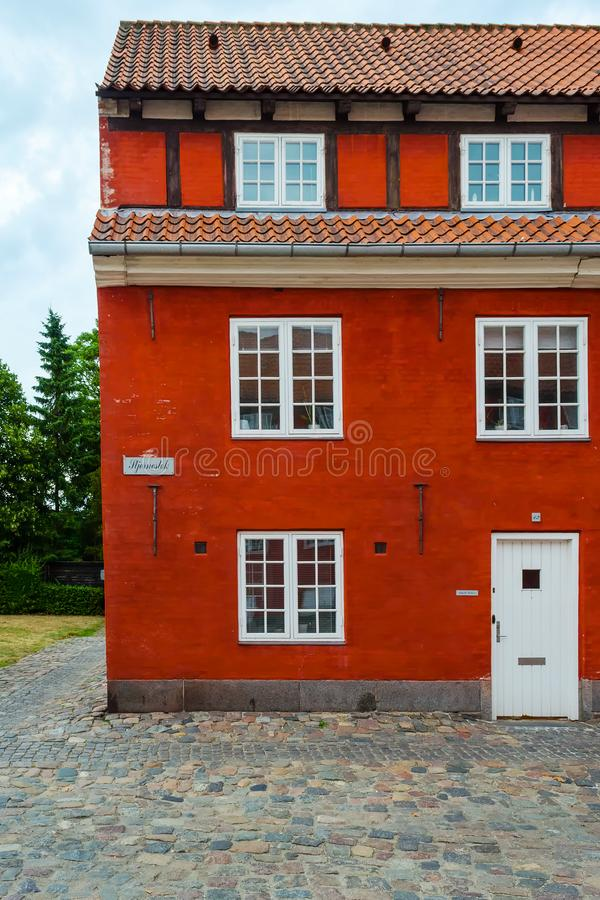 Beautiful facade of an old red brick building with white windows. stock images