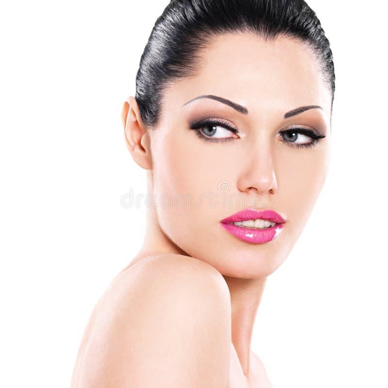 Beautiful face of caucasian woman with pink lips stock photos