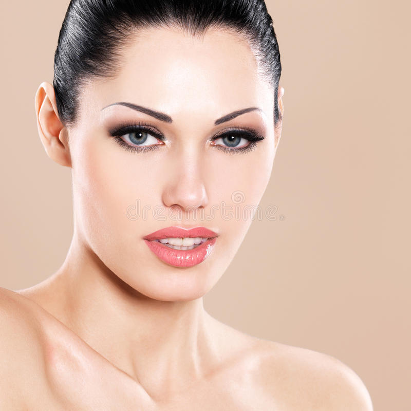 Beautiful face of caucasian woman with pink lips royalty free stock images