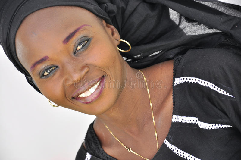 Beautiful face of a creole women wearing makeup stock photo