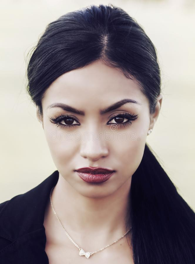 Beautiful face of exotic woman royalty free stock images